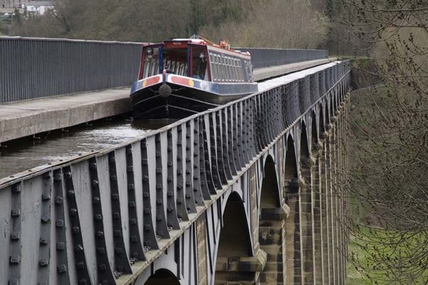 """""""A barge crosses the Pontycysyllte aqueduct on the Llangollen Canal, North Wales. The aqueduct was designed by Thomas Telford and completed in 1805. It crosses the River Dee and is the longest and highest aqueduct in Britain. I have had to use ISO 400 on this shot to freeze the motion of the barge and maintain an appropriate depth of field."""""""